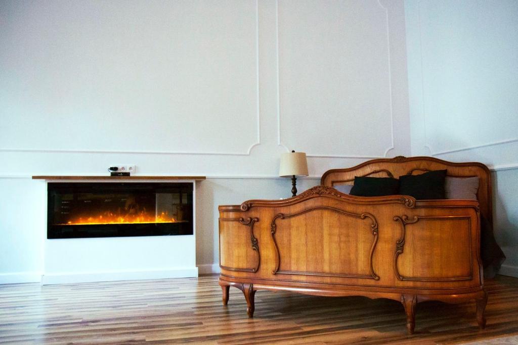 Łóżko lub łóżka w pokoju w obiekcie Royal Apartment