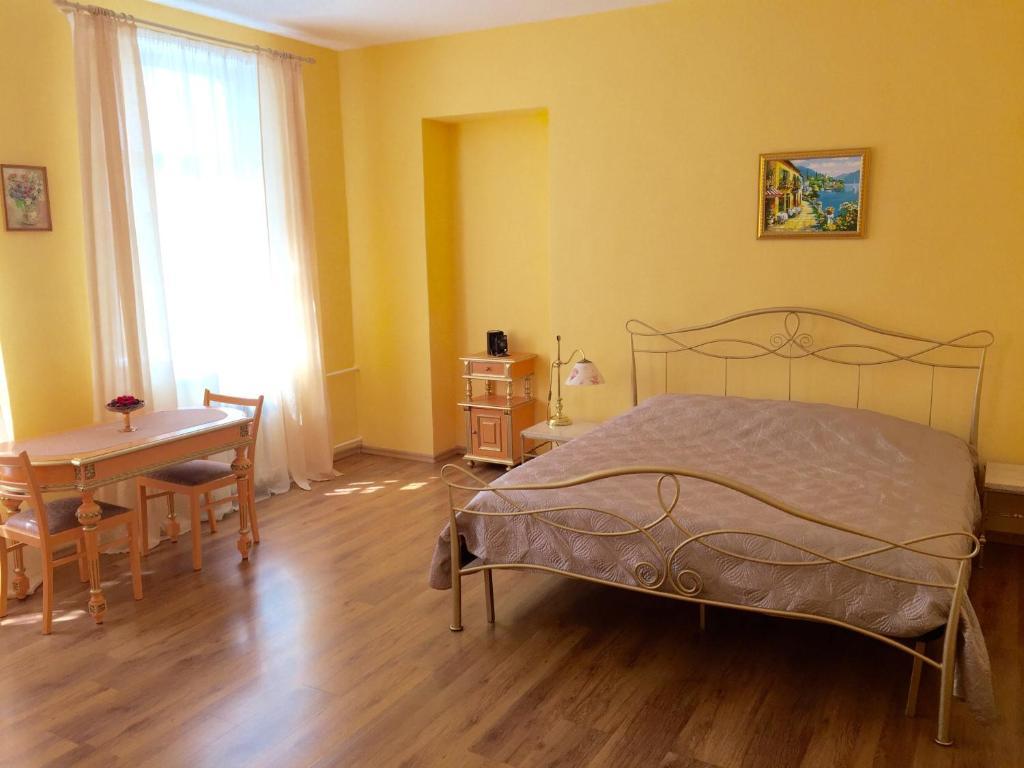 Кровать или кровати в номере Апартаменты в историческом центре