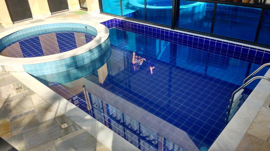 The swimming pool at or close to Pousada Ubuntu