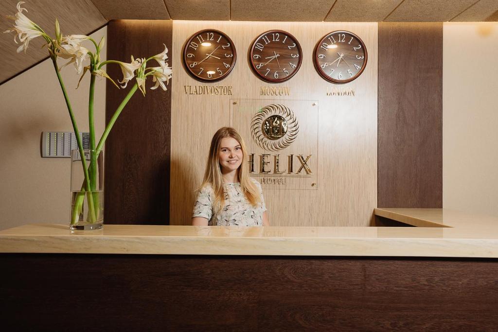 Лобби или стойка регистрации в Helix Hotel