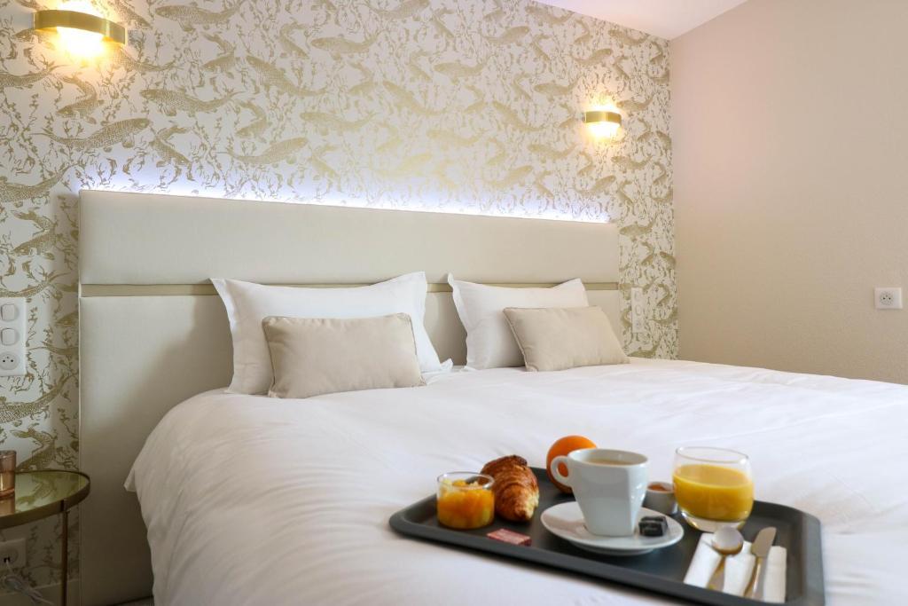 Options de petit-déjeuner proposées aux clients de l'établissement Hotel l'Ortega Rennes Aeroport