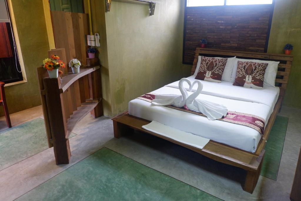 Ein Bett oder Betten in einem Zimmer der Unterkunft Phang-nga cottage