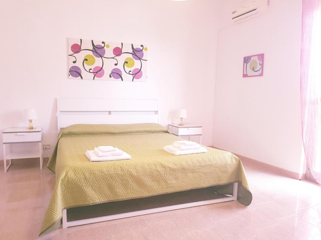Letto o letti in una camera di Casa Vacanze Visit Puglia