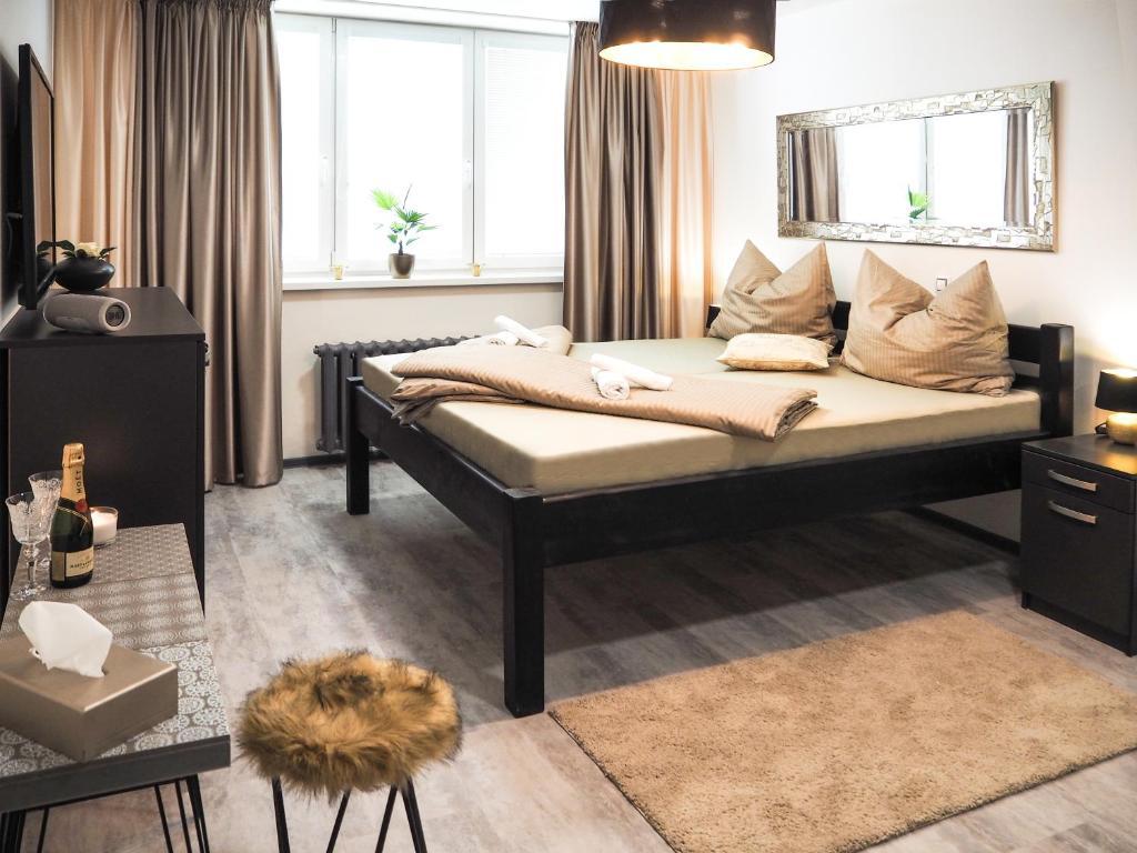 Postel nebo postele na pokoji v ubytování Diamond Apartments