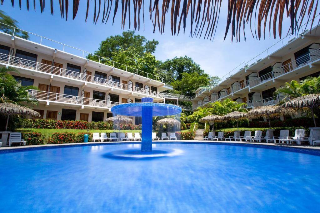The swimming pool at or near Hotel Arenas en Punta Leona