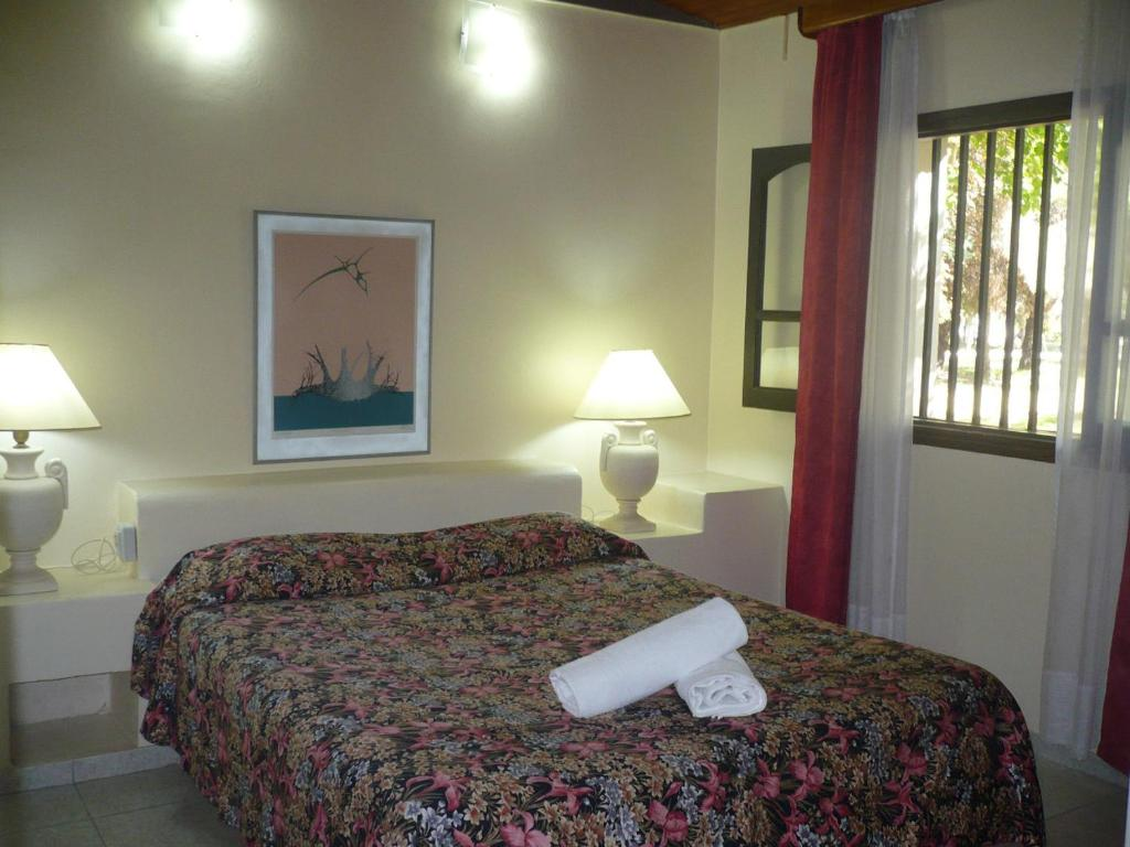 A bed or beds in a room at Exclusive Centro Turistico
