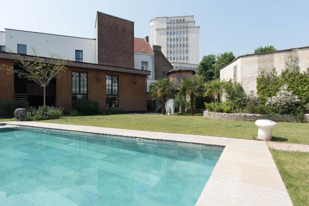 The swimming pool at or near B&B Koto
