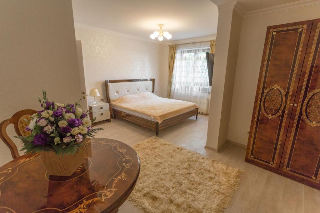 Кровать или кровати в номере АпартОтель Пушкин