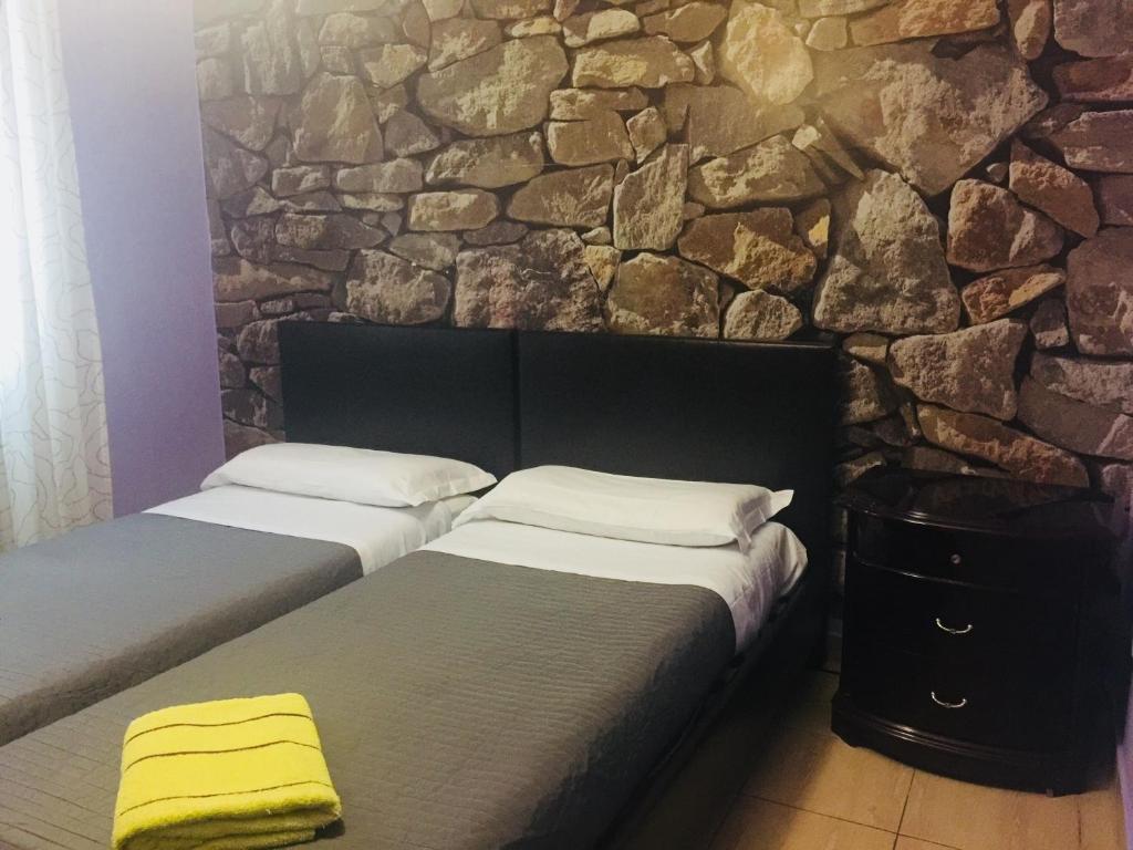 Ein Bett oder Betten in einem Zimmer der Unterkunft Rome City Hostel