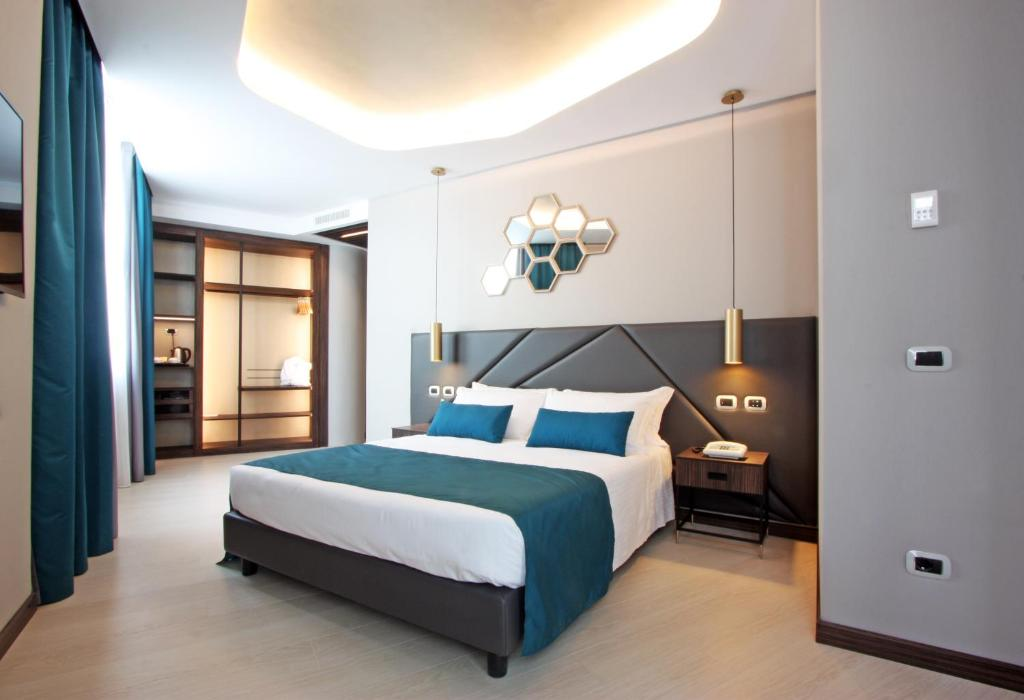 A bed or beds in a room at The Hive Hotel