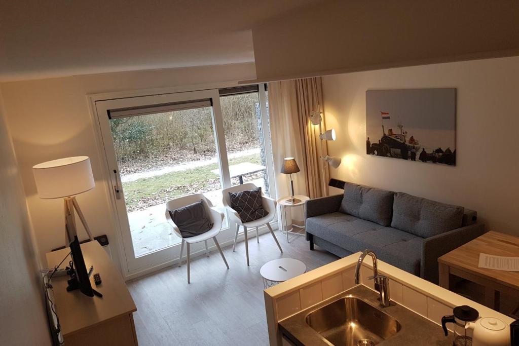 Ein Sitzbereich in der Unterkunft Kaap appartementen