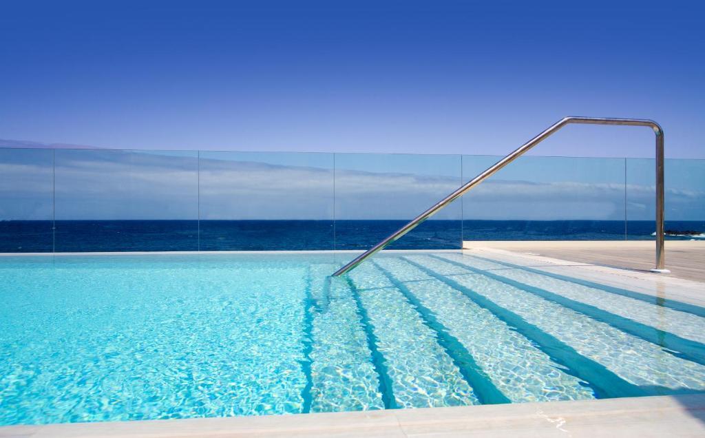 The swimming pool at or near Hotel Ereza Mar