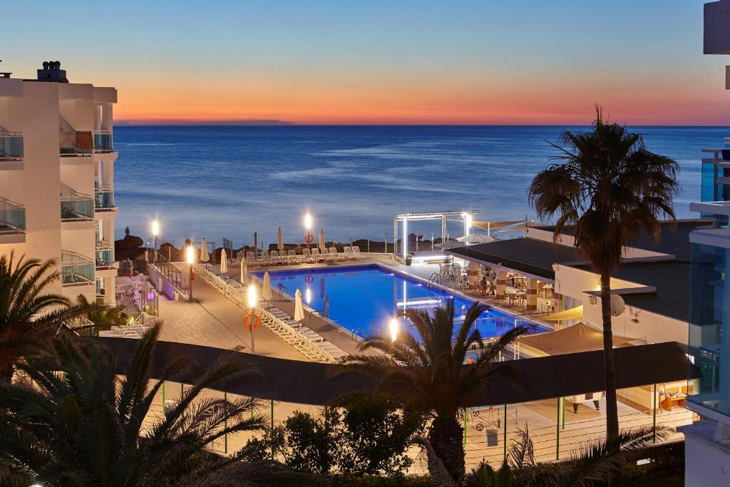 A view of the pool at Aparthotel Nereida or nearby