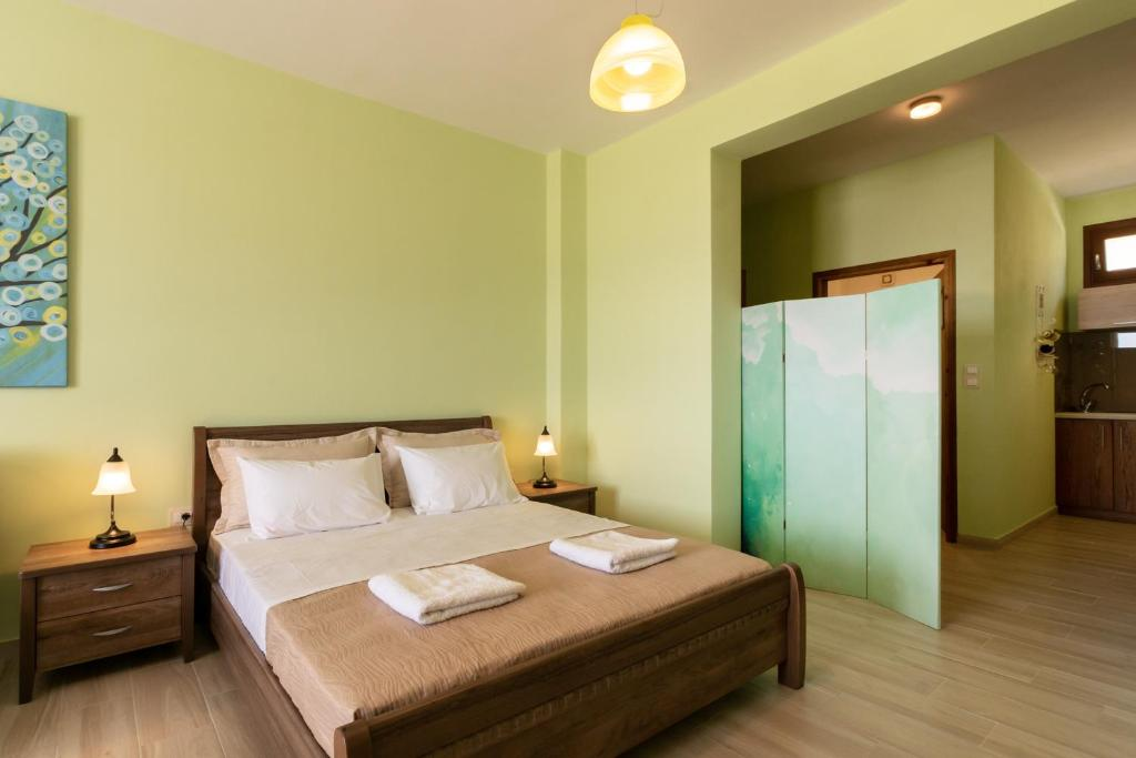A bed or beds in a room at Anasa