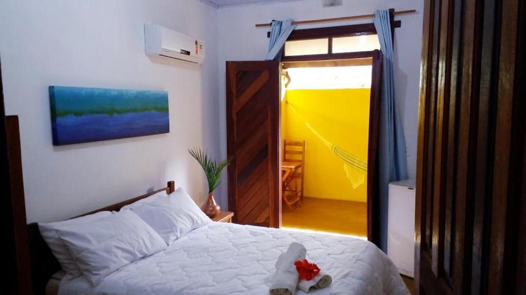 Cama ou camas em um quarto em Pousada Corais Do Sul