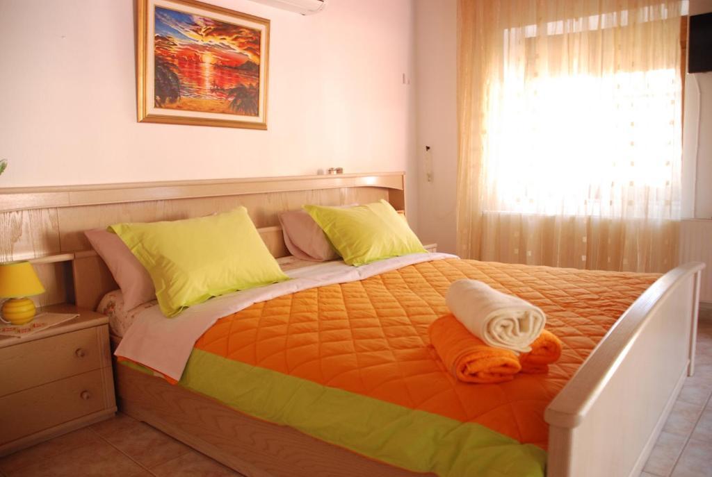 A bed or beds in a room at Villa Aleka
