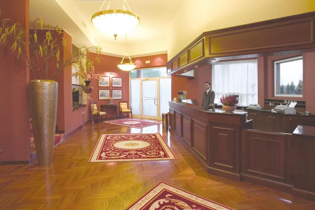 The lobby or reception area at Hotel Maxim
