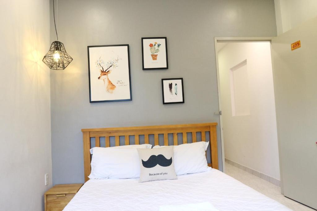 A bed or beds in a room at Long Hostel