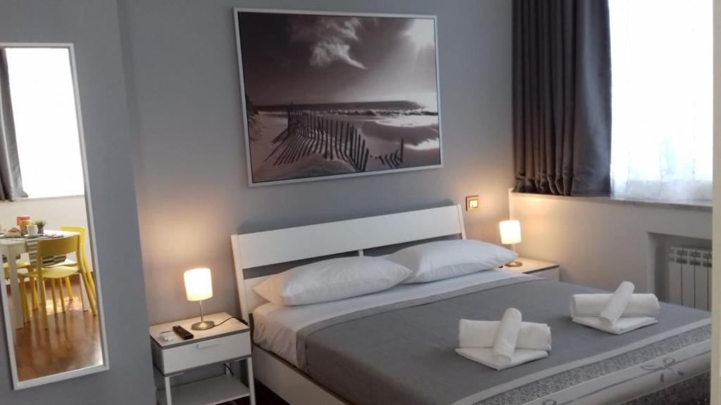 A bed or beds in a room at Alta Quota Central on the Sea