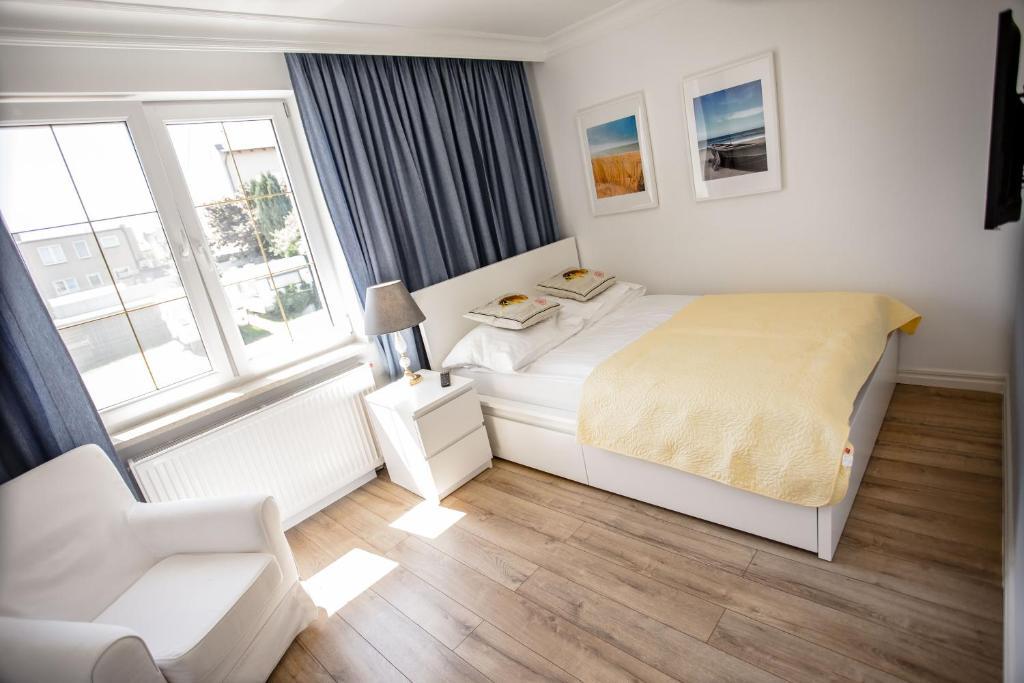 Łóżko lub łóżka w pokoju w obiekcie Willa Balticana
