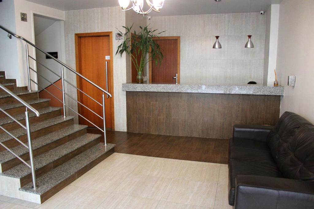 The lobby or reception area at Hotel Palmeiras Ltda