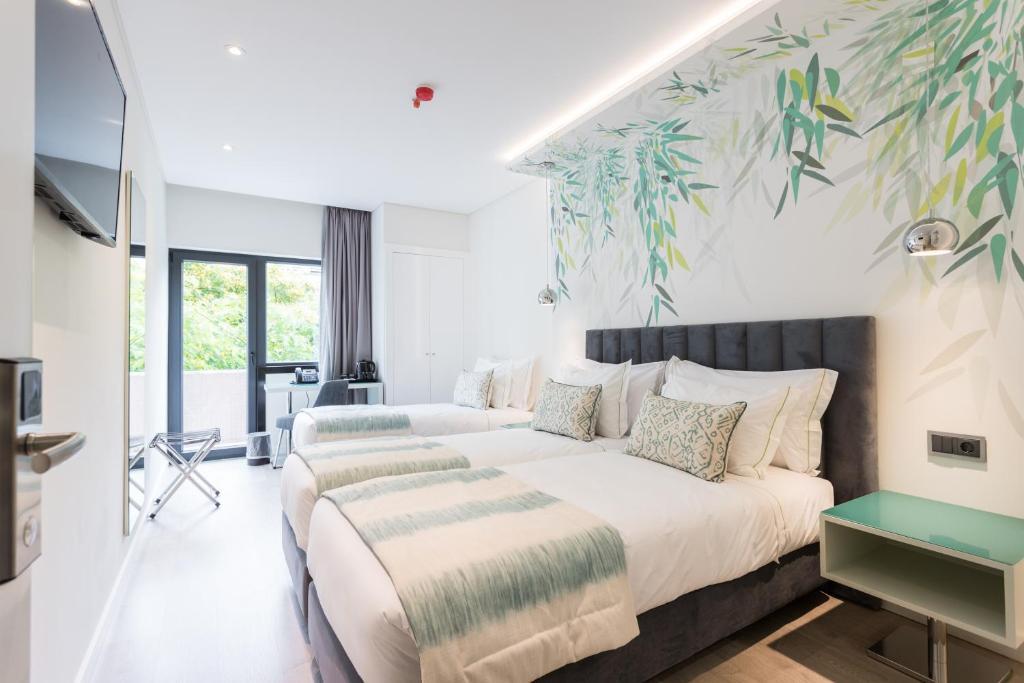 Cama o camas de una habitación en Hotel Capital