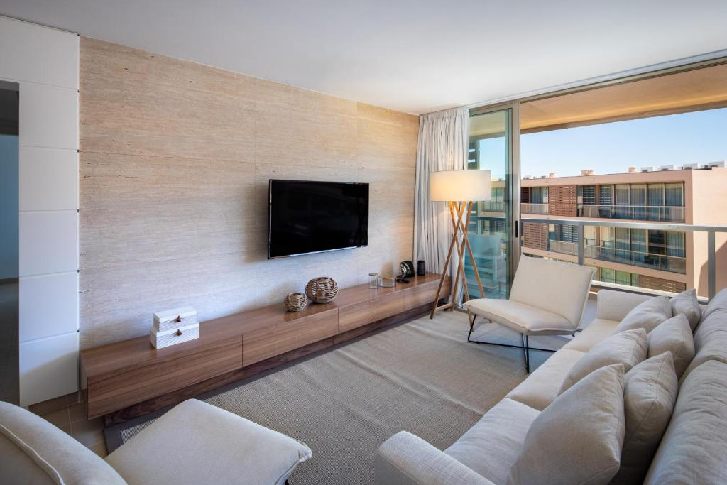 A television and/or entertainment center at the Quest - Luxury Beach Apartment