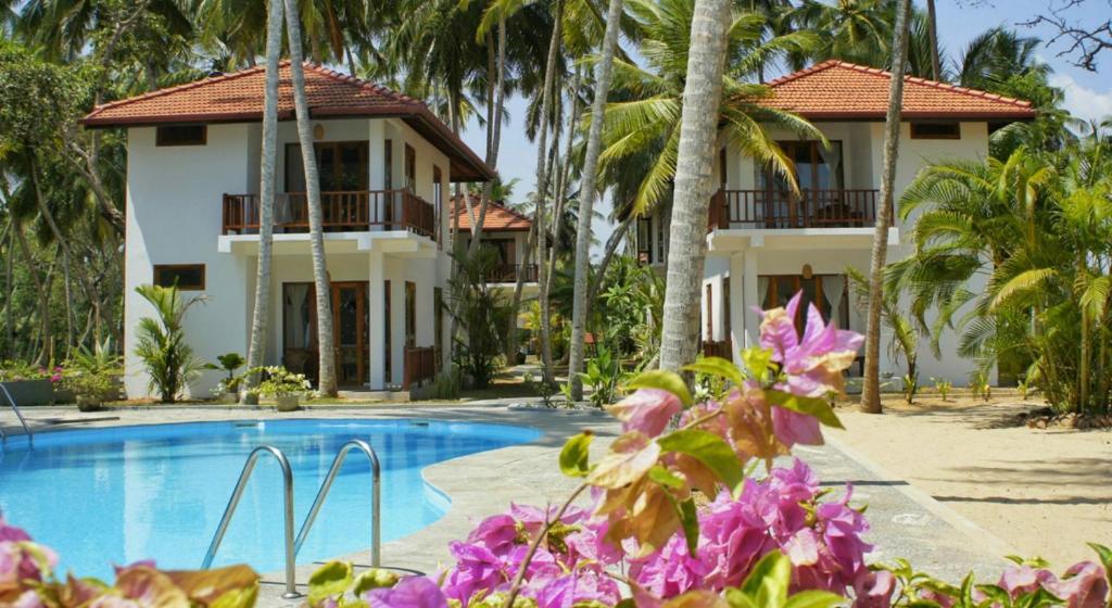 The swimming pool at or near Good Karma Ayurvedic Resort