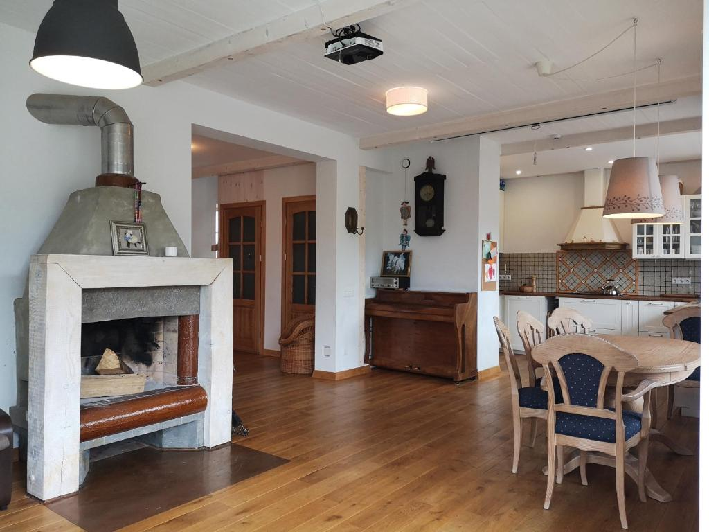 A kitchen or kitchenette at 9 min from Palanga! luxury house on the river and sauna