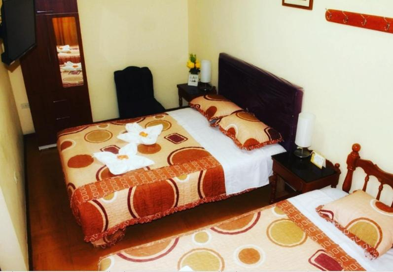 A bed or beds in a room at Hotel Independencia