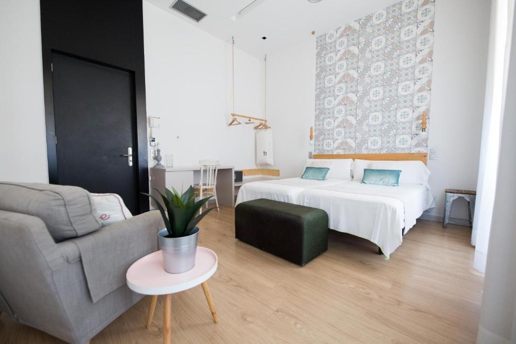 Cama o camas de una habitación en Hotel Boutique Bedandchic