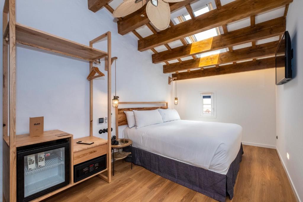 Letto o letti in una camera di Nao Catedral Boutique Hotel