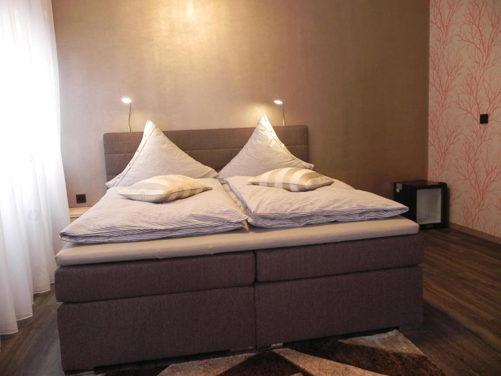 A bed or beds in a room at Arkade