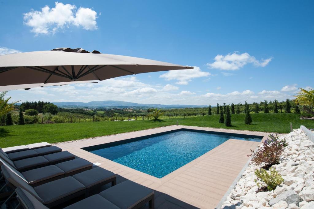 The swimming pool at or near Quinta Roninho