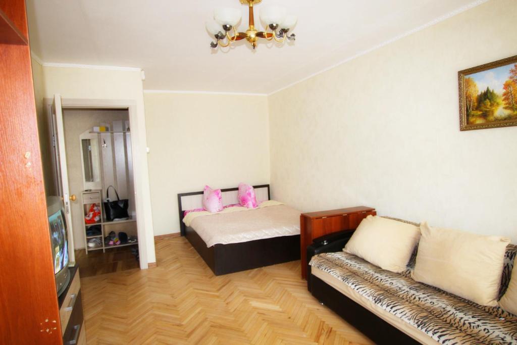 Кровать или кровати в номере Park Kolomenskoe