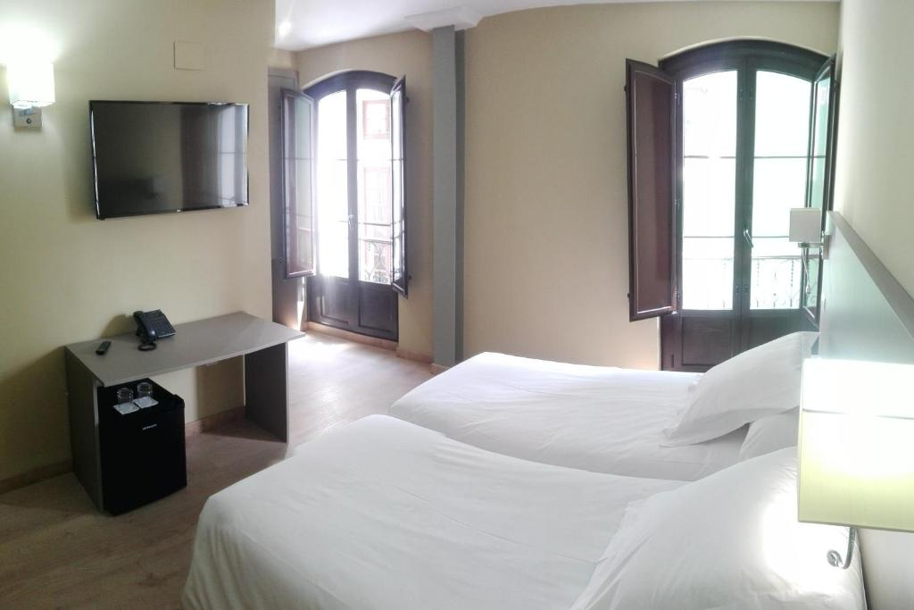 A bed or beds in a room at Hotel Areces