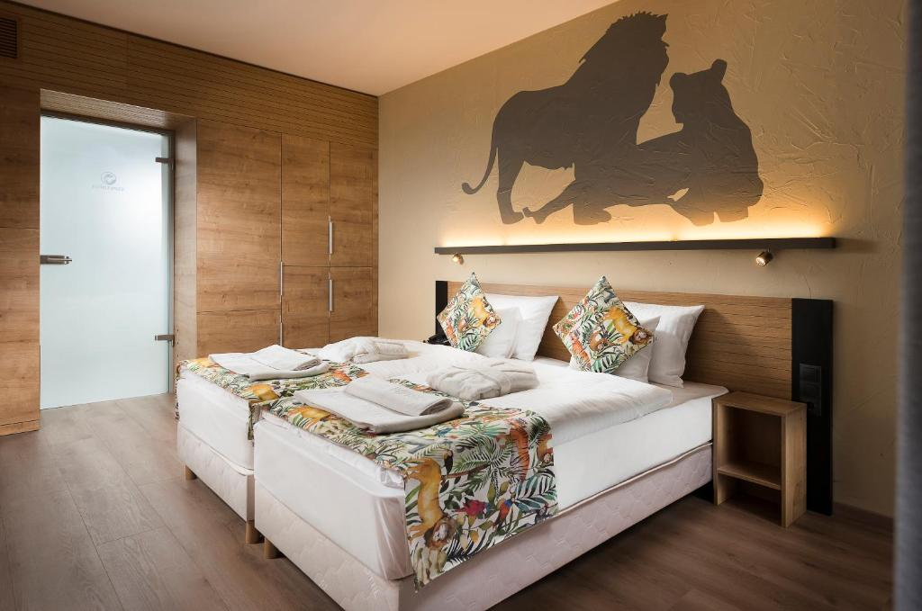 A bed or beds in a room at Pangea Hotel