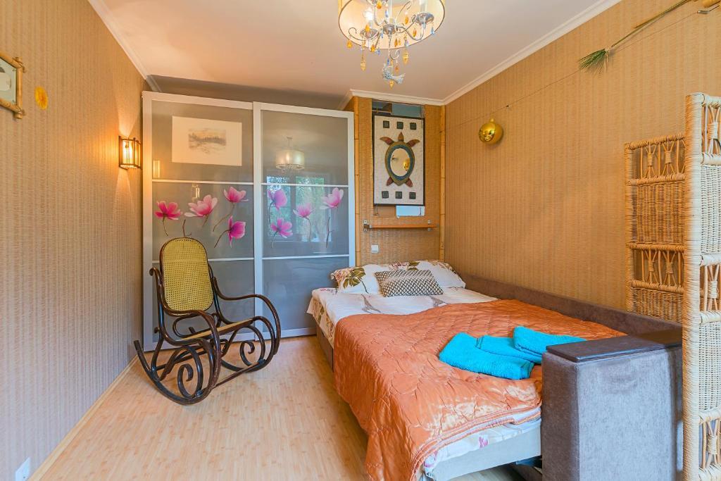 Кровать или кровати в номере Bolshevikov