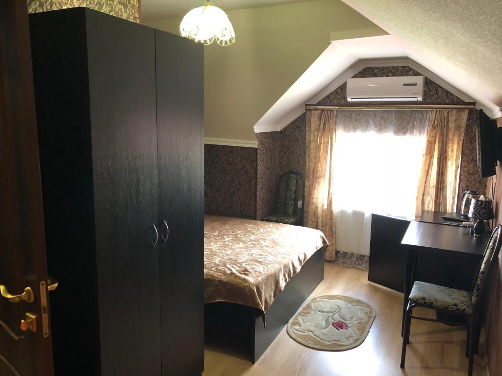 Кровать или кровати в номере Мини-отель «5 сезонов»