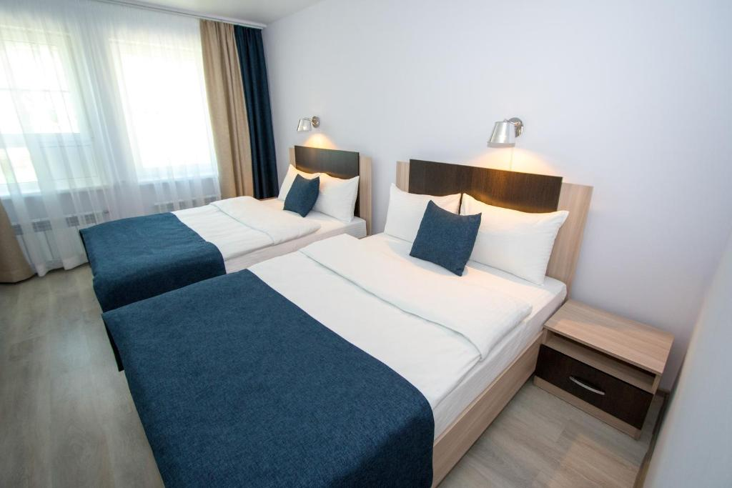Кровать или кровати в номере Отель ВЕРА