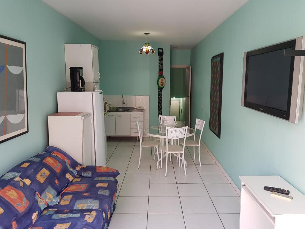 Uma área de estar em Duplex charmoso 406 Green