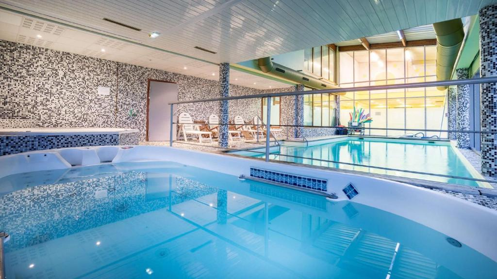 The swimming pool at or near Best Western Hotel Ile de France