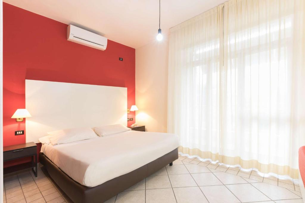 A bed or beds in a room at Best Western La Baia