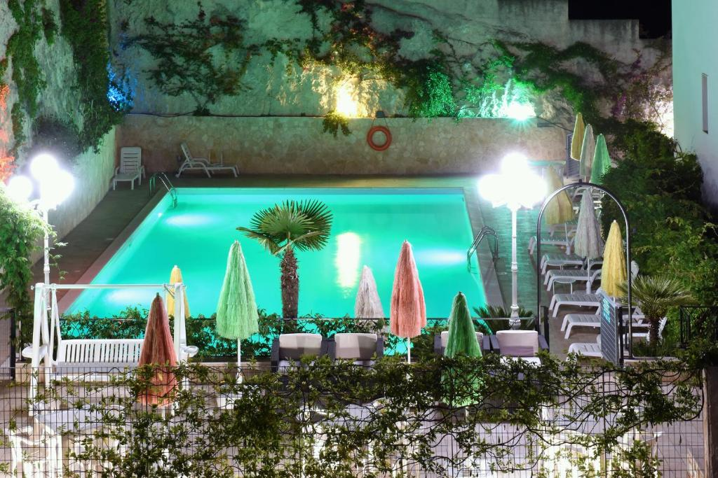 A view of the pool at Hotel Timiama or nearby
