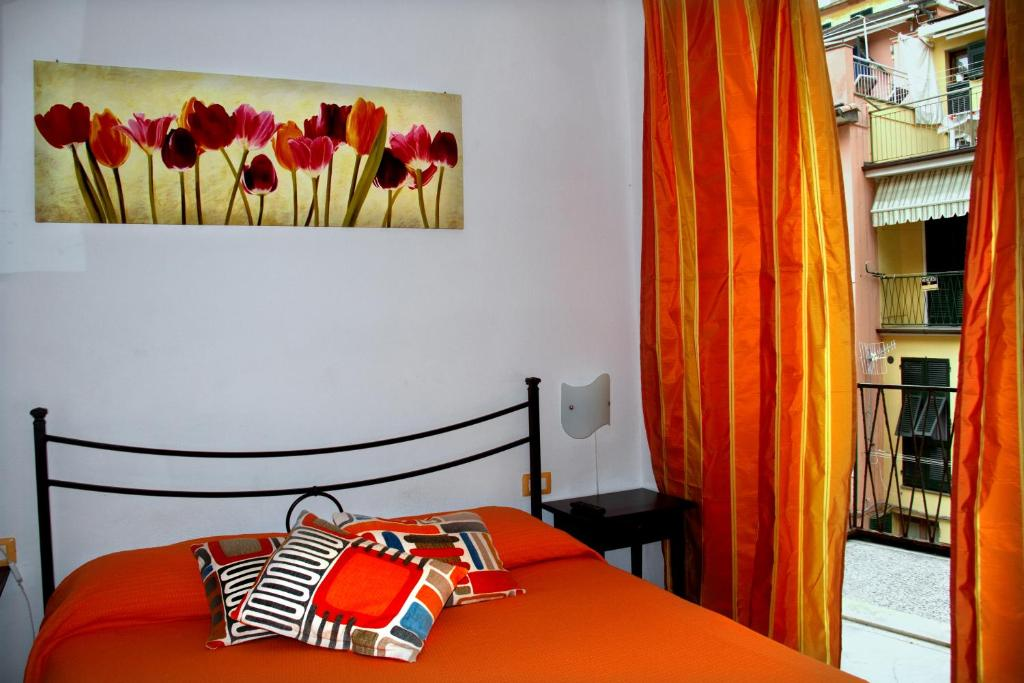 A bed or beds in a room at Affittacamere Rollando
