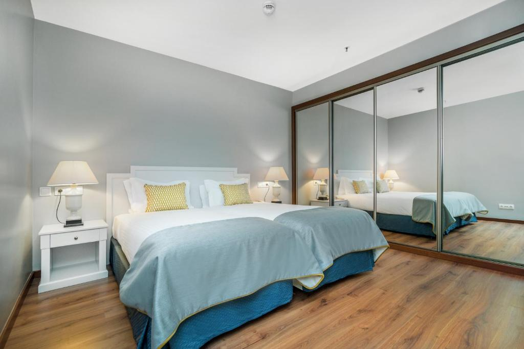 A bed or beds in a room at Gaia Residence