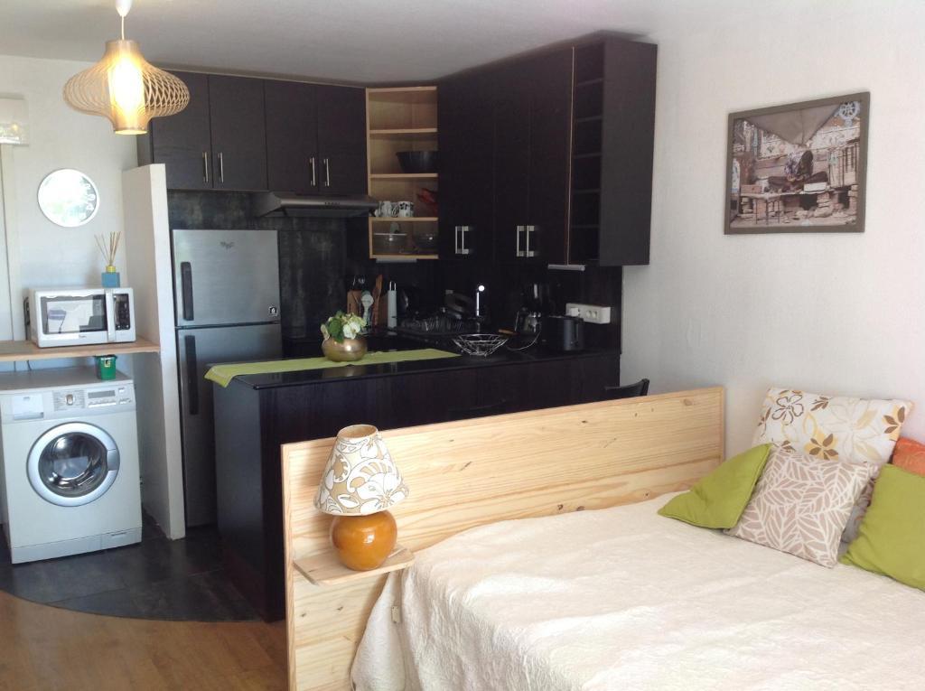 A cozinha ou cozinha compacta de Studio Tiare Papeete centre