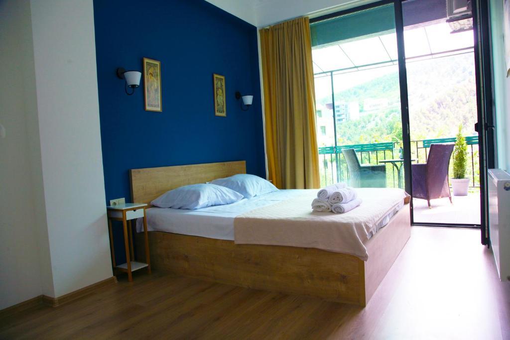 Кровать или кровати в номере Old Town Apartments With Terrace