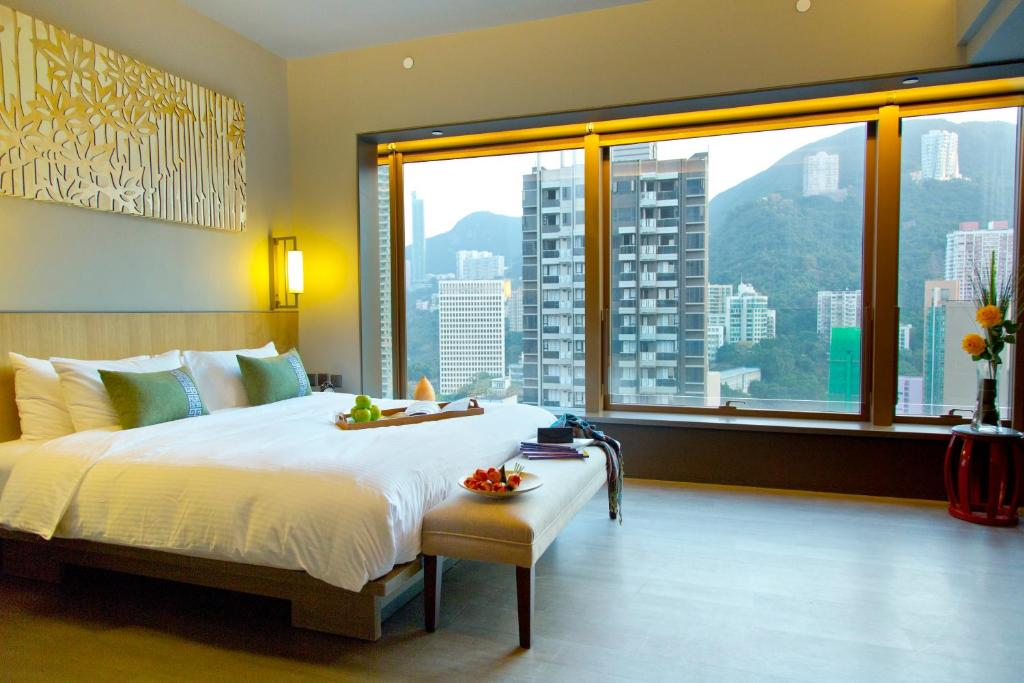 A bed or beds in a room at Wanchai 88