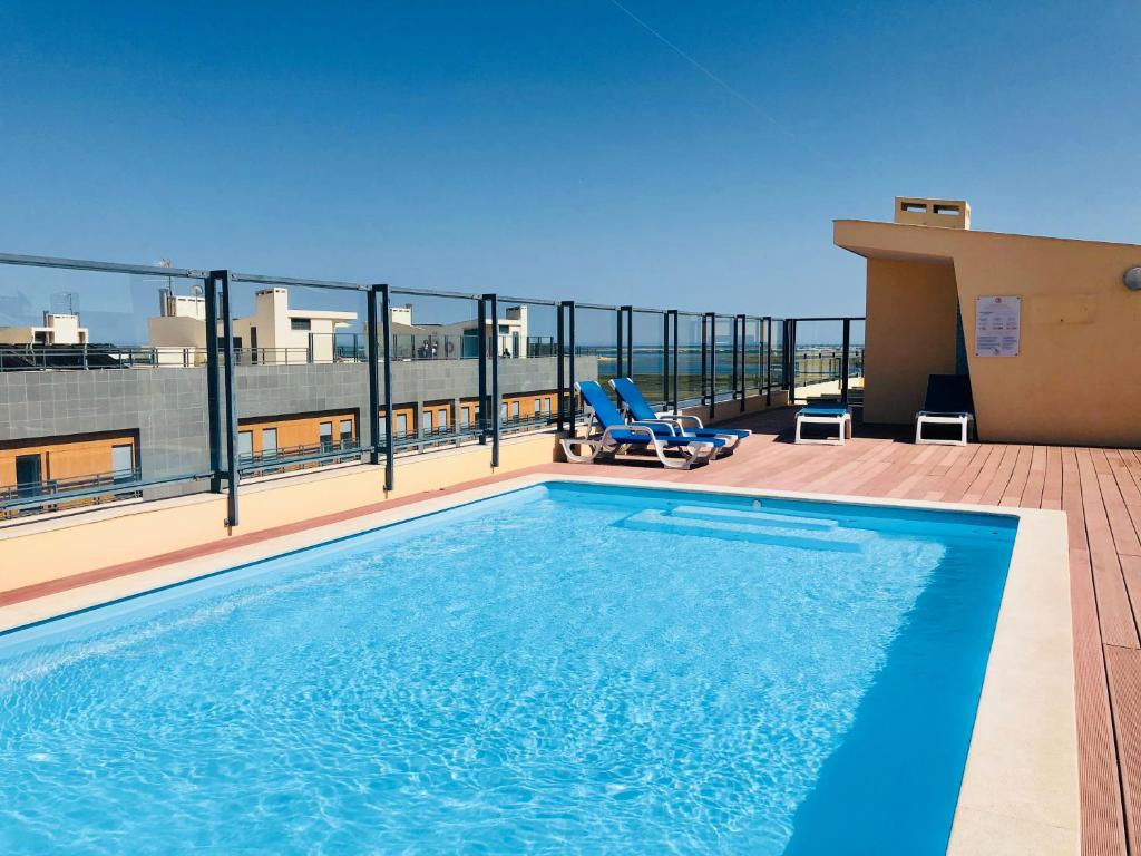 The swimming pool at or near Ria Formosa